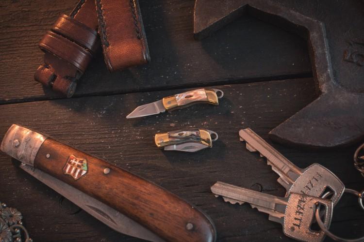 Sharp Mini Folding Pocket Knife Keychain with Brass Finish & Shell Handling Insert from STRAPSANDBRACELETS