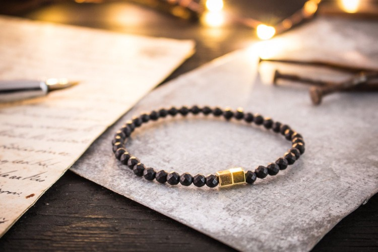Zacharii - 4mm - Faceted Matte Black Onyx Beaded Stretchy Bracelet with Gold Cube Beads from STRAPSANDBRACELETS