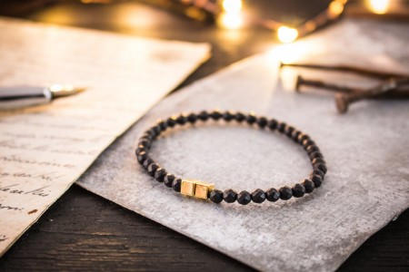 Zacharii - 4mm - Faceted Matte Black Onyx Beaded Stretchy Bracelet with Gold Cube Beads