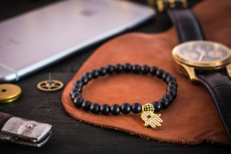 Copelyn - 6mm - Matte Black Onyx Beaded Stretchy Bracelet with Gold Micro Pave Hamsa Hand Charm & Ball