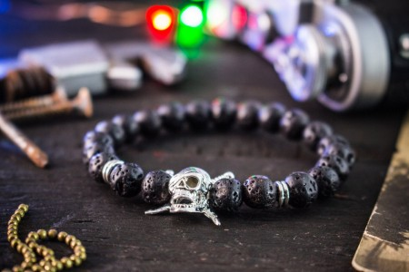 Ruaraidh - 8mm - Black Lava Stone Beaded Stretchy Bracelet with Silver Pirate Skull